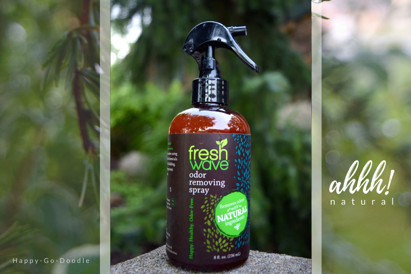 Fresh Wave Odor Removing Spray with soft green, natural foliage in background
